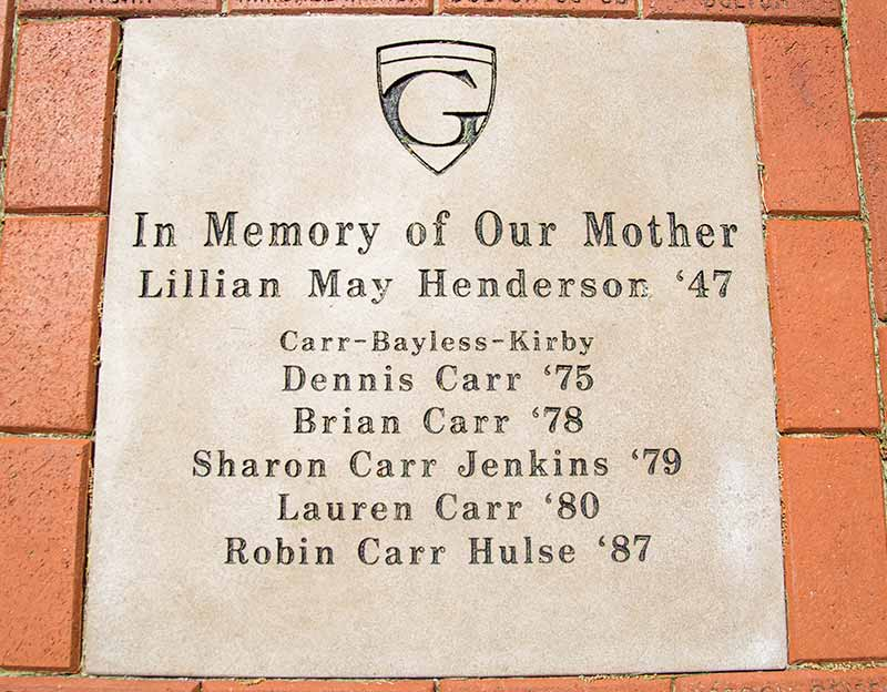 large etched concrete pad with Graceland shield logo: In Memory of Our Mother, Lillian May Henderson `47, Carr-Bayless-Kirby, Dennis Carr `75, Brian Carr `78, Sharon Carr Jenkins `79, Lauren Carr `80, Robin Carr Hulse `87